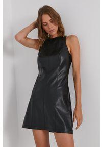 Calvin Klein Jeans - Sukienka. Kolor: czarny. Materiał: tkanina, skóra. Wzór: gładki. Typ sukienki: rozkloszowane