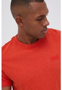 Superdry - T-shirt bawełniany. Okazja: na co dzień. Kolor: pomarańczowy. Materiał: bawełna. Wzór: nadruk. Styl: casual