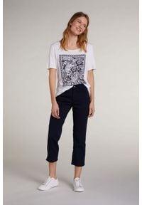 T-shirt z tropikalnym nadrukiem oraz ozdobnymi kryształkami Oui. Kolor: biały. Materiał: lyocell, bawełna. Długość rękawa: krótki rękaw. Długość: krótkie. Wzór: nadruk