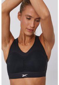 Reebok - Biustonosz sportowy. Kolor: czarny. Rodzaj stanika: odpinane ramiączka, wyciągane miseczki