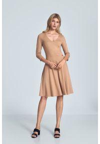 e-margeritka - Sukienka koktajlowa wizytowa beżowa - l. Okazja: do pracy. Kolor: beżowy. Materiał: poliester, wiskoza, materiał, elastan. Typ sukienki: rozkloszowane. Styl: wizytowy