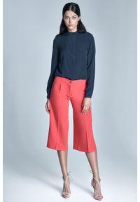 Pomarańczowe spodnie Nife eleganckie