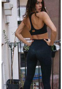 MUUV - Biustonosz sportowy Basic. Kolor: czarny. Materiał: materiał. Rodzaj stanika: odpinane ramiączka