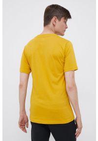 New Balance - T-shirt. Okazja: na co dzień. Kolor: żółty. Wzór: nadruk. Styl: casual