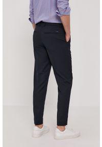 Armani Exchange - Spodnie. Kolor: niebieski. Materiał: tkanina. Wzór: gładki