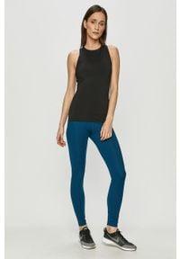 Nike - Legginsy. Kolor: niebieski. Materiał: tkanina, dzianina, poliester, elastan, włókno, skóra. Wzór: gładki #4