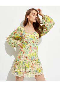LOVE SHACK FANCY - Wzorzysta sukienka Ambrosia. Kolor: żółty. Materiał: koronka, jedwab, bawełna. Wzór: kwiaty. Typ sukienki: rozkloszowane. Długość: mini