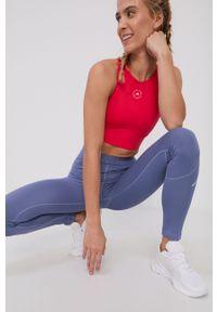 Adidas by Stella McCartney - adidas by Stella McCartney - Biustonosz sportowy. Kolor: różowy. Materiał: poliester. Rodzaj stanika: odpinane ramiączka