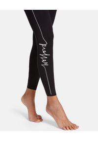 Wolford - WOLFORD - Czarne legginsy z logo. Stan: podwyższony. Kolor: czarny. Materiał: tkanina. Długość: długie