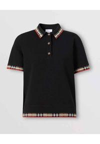 Burberry - BURBERRY - Dzianinowa koszulka polo. Typ kołnierza: polo. Kolor: czarny. Materiał: dzianina. Wzór: kratka, aplikacja. Styl: klasyczny
