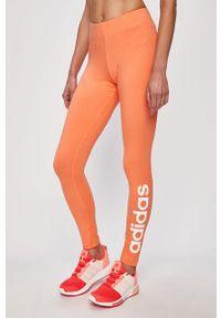 Pomarańczowe legginsy Adidas z nadrukiem