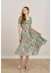 Marie Zélie - Sukienka Rosa Jasmine. Typ kołnierza: kokarda. Materiał: tkanina, wiskoza, len, materiał. Długość rękawa: krótki rękaw. Długość: midi