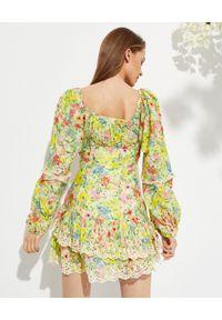 LOVE SHACK FANCY - Wzorzysta sukienka Ambrosia. Kolor: żółty. Materiał: bawełna, jedwab, koronka. Wzór: kwiaty. Typ sukienki: rozkloszowane. Długość: mini