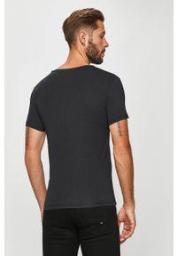 Guess Jeans - T-shirt. Okazja: na co dzień. Kolor: czarny. Materiał: jeans. Styl: casual