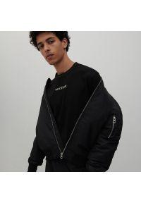 Reserved - Bluzka z długim rękawem z motywem z filmu Matrix - Czarny. Kolor: czarny. Długość rękawa: długi rękaw. Długość: długie