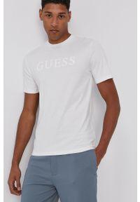 Guess - T-shirt. Okazja: na co dzień. Kolor: beżowy. Materiał: bawełna. Wzór: nadruk. Styl: casual