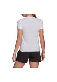 Adidas - Koszulka damska adidas Travel Graphic Tee GR9986. Materiał: dzianina, bawełna. Długość rękawa: krótki rękaw. Długość: krótkie