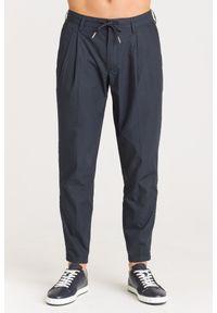 Spodnie dresowe Armani Exchange w kolorowe wzory