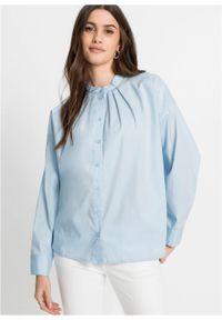 Bluzka oversize bonprix pudrowy niebieski. Kolor: fioletowy