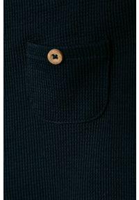 Niebieskie spodnie dresowe Name it