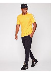 Adidas - adidas T-Shirt Essentials EI9839 Żółty Regular Fit. Kolor: żółty