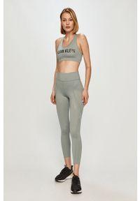 Zielony biustonosz sportowy Calvin Klein Performance z nadrukiem, z odpinanymi ramiączkami
