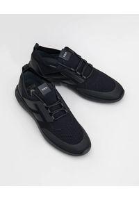 TOD'S - Czarne sportowe sneakersy. Okazja: na co dzień, na spacer. Kolor: czarny. Materiał: tkanina, puch, dresówka, guma. Sport: turystyka piesza