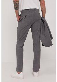 Tommy Hilfiger Tailored - Spodnie. Kolor: szary