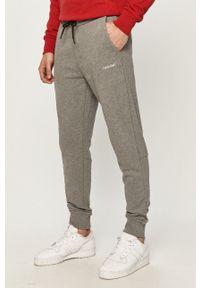 Calvin Klein - Spodnie. Okazja: na co dzień. Kolor: szary. Materiał: bawełna. Styl: casual