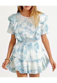 LOVE SHACK FANCY - Błękitna sukienka z falbankami Natasha. Typ kołnierza: kołnierz z falbankami. Kolor: niebieski. Materiał: bawełna, koronka. Wzór: koronka, ażurowy. Długość: mini
