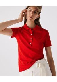 Lacoste - LACOSTE - Koszulka polo z bawełnianej piki. Typ kołnierza: polo. Kolor: czerwony. Materiał: bawełna. Wzór: haft. Styl: elegancki, sportowy