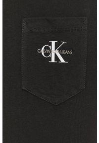 Calvin Klein Jeans - T-shirt. Okazja: na co dzień. Kolor: czarny. Materiał: bawełna. Wzór: aplikacja. Styl: casual