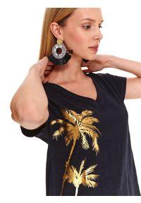 DRYWASH - T-shirt damski z błyszczącym nadrukiem palm. Typ kołnierza: dekolt w serek. Kolor: niebieski. Materiał: bawełna. Długość: długie. Wzór: nadruk. Sezon: jesień. Styl: wakacyjny