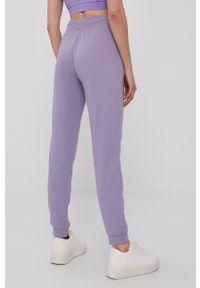 adidas Originals - Spodnie. Kolor: fioletowy. Materiał: tkanina. Wzór: gładki