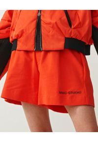 MMC STUDIO - Pomarańczowe spodenki z haftem Gum. Stan: podwyższony. Kolor: pomarańczowy. Materiał: guma. Wzór: haft