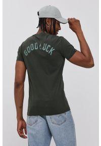 Superdry - T-shirt bawełniany. Kolor: zielony. Materiał: bawełna. Wzór: nadruk