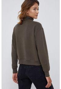 Calvin Klein Jeans - Bluza bawełniana. Okazja: na co dzień. Typ kołnierza: golf. Kolor: zielony. Materiał: bawełna. Długość rękawa: długi rękaw. Długość: długie. Wzór: nadruk. Styl: casual