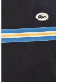 Lacoste - T-shirt. Kolor: niebieski. Wzór: nadruk