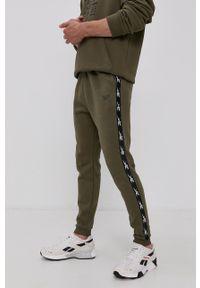 Reebok - Spodnie. Okazja: na co dzień. Kolor: zielony. Styl: casual