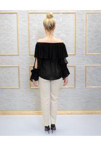 EMMA & GAIA - Czarna bluzka z falbanami. Kolor: czarny. Wzór: aplikacja. Styl: klasyczny