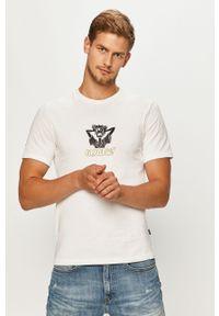 Biały t-shirt Converse casualowy, z okrągłym kołnierzem, z nadrukiem, na co dzień