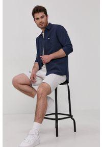 Tommy Jeans - Koszula bawełniana. Okazja: na co dzień. Typ kołnierza: kołnierzyk włoski. Kolor: niebieski. Materiał: bawełna. Długość rękawa: długi rękaw. Długość: długie. Wzór: aplikacja. Styl: casual