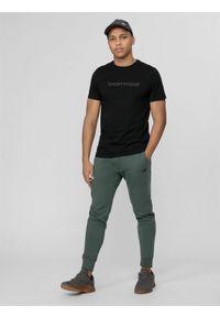 4f - Spodnie dresowe męskie. Kolor: morski. Materiał: dresówka