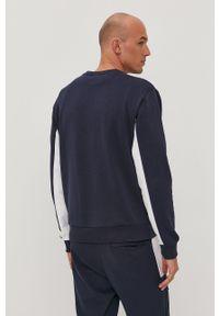 New Balance - Bluza. Kolor: niebieski. Materiał: dzianina. Wzór: gładki
