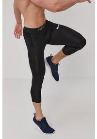Czarne legginsy sportowe z nadrukiem, Dri-Fit (Nike)