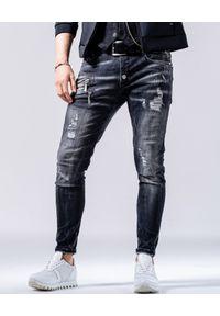 GUNS & TUXEDOS - Szare spodnie jeansowe z dziurami Low Rider. Kolor: szary. Styl: elegancki