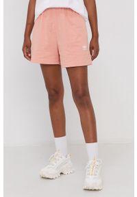 adidas Originals - Szorty. Okazja: na co dzień. Kolor: pomarańczowy. Materiał: dzianina, bawełna. Wzór: gładki. Styl: casual