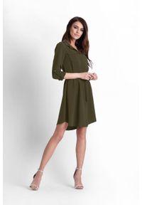 e-margeritka - Sukienka koszulowa do kolan khaki - 36. Okazja: do pracy. Kolor: brązowy. Materiał: poliester, materiał, elastan. Długość rękawa: długi rękaw. Sezon: wiosna. Typ sukienki: koszulowe. Styl: elegancki. Długość: midi