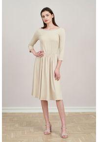 Marie Zélie - Sukienka Limosa waniliowa. Materiał: wiskoza, dzianina, materiał, elastan. Długość: midi