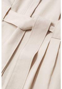 mango - Mango - Kombinezon Jill. Okazja: na co dzień. Kolor: beżowy. Materiał: włókno, lyocell, tkanina. Długość rękawa: długi rękaw. Długość: długie. Wzór: gładki. Styl: casual